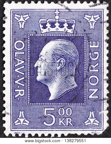 MOSCOW RUSSIA - JANUARY 2016: a post stamp printed in NORWAY shows a portrait of King Olav V the series