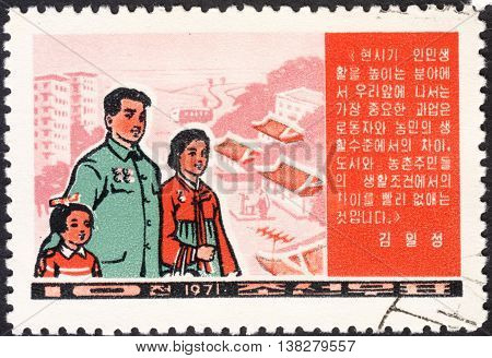 MOSCOW RUSSIA - CIRCA JANUARY 2016: a post stamp printed in the NORTH KOREA shows a family devoted to Improvement in Living Standards circa 1971