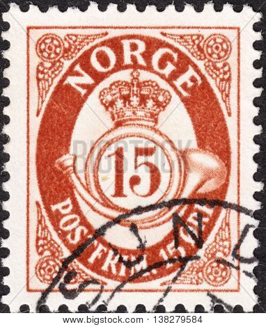 NORWAY - CIRCA 1921: A stamp printed in NORWAY shows image of crown and post horn the series