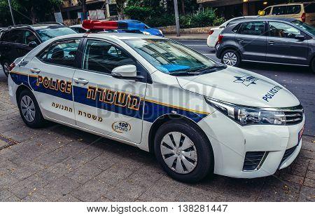 Tel Aviv Israel - October 19 2015. Police car parked on pavement in Tel Aviv
