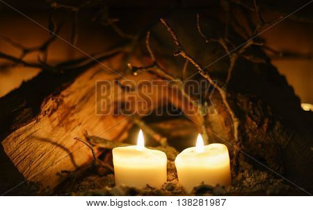 candles and fire wood table on dark background