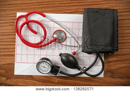 Medical concept. Medical manometer and a stethoscope on a wooden background