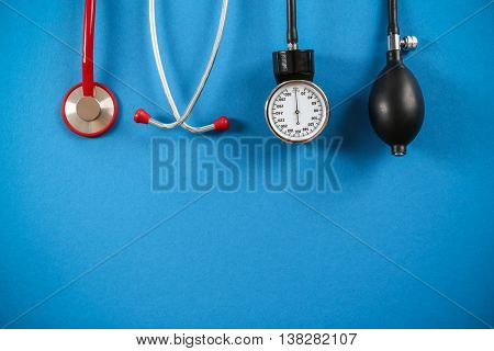 Medical concept. Medical manometer and a stethoscope on a blue background