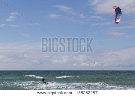 Tisvilde, Denmark - July 09, 2016: A kite surfer at Tisvilde beach.