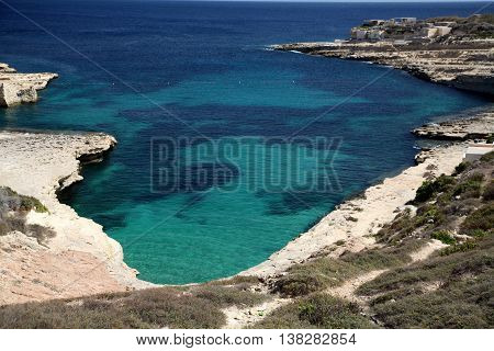 A favourite bathing spot in Malta at Delimara looking down on the bright blue sea