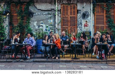 Tel Aviv Israel - October 20 2015. People sits at tables outside the restaurant at Rothschild Boulevard in Tel Aviv