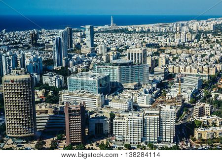 Tel Aviv Israel - October 21 2015. Aerial view from 49th floor of Circular Tower one of three skyscrapers of Azrieli Center complex in Tel Aviv. Sourasky Medical Center in the center of the image