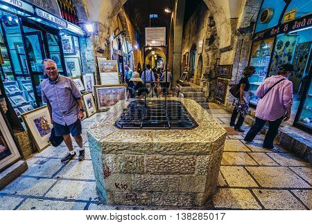 Jerusalem Israel - October 22 2015. Tourists walks next to well on north-south-oriented ancient street called Cardo renovated and covered with the arched roof in Jerusalem