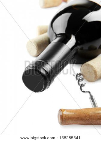Red wine with corkscrew, isolated on white