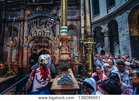 Jerusalem Israel - October 22 2015. Tourists and pilgrims walks through so called Aedicule situated inside the Church of the Holy Sepulchre in Jerusalem