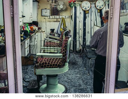 Jerusalem Israel - October 22 2015. Man stands in barber's shop on Arab baazar located inside the walls of the Old City of Jerusalem