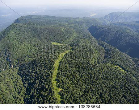 The Mountain Ridge Covered Forest. The Road In The Forest. Mountain Landscape.
