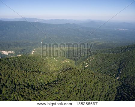The Mountain Ridge Covered  Forest. Mountain Landscape. The Bird's-eye View.