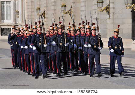 MADRID, SPAIN - OCTOBER 25: Royal Guards participate in the Changing of the Guards outside Madrid's Royal Palace on October 25, 2010 in Madrid, capital of Spain.