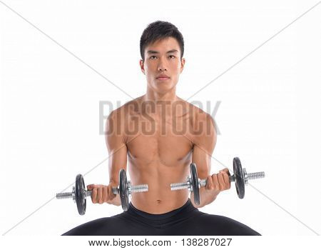portrait of a muscular man lifting weights