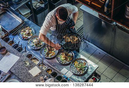 Jerusalem Israel - October 22 2015. Man prepares food in famous Machneyuda restaurant