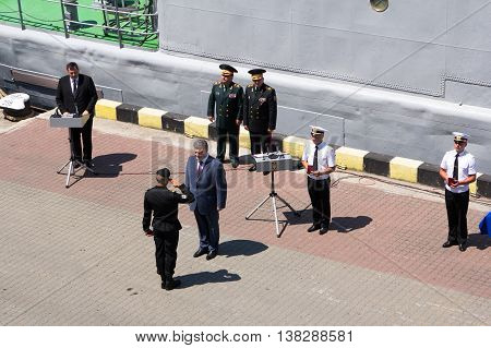 Odesa, Ukraine - July 03, 2016: President of Ukraine Petro Poroshenko awards sailors and soldiers on the pier of the Odessa port. Navy day celebration in Odesa