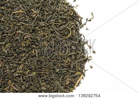 Organic Green Tea (Camellia sinensis) dried long leaves. Macro close up background texture. Top view.