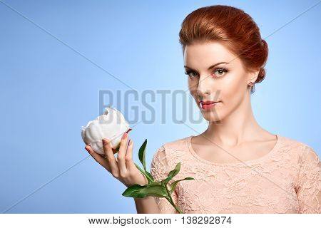 Fashion Natural Makeup. Beauty portrait woman in Fashion dress. Redhead Model girl with flower, fashion Hairstyle, Makeup. Green Eyes, Eyelashes. Skincare fashion concept.Creative unusual natural look