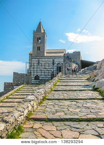 Paved steps of the famous gothic Church of St. Peter, Chiesa di San Pietro, in Porto Venere, Ligurian Coast, La Spezia, Italy.