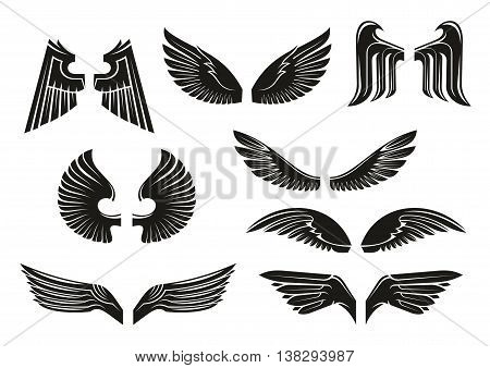 Black heraldic wings set in tribal style for tattoo and book, heraldry or religious design isolated on white. Vintage or retro birds and angel wings