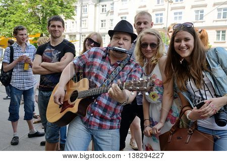 VILNIUS, LITHUANIA - MAY 18: Unidentified musician play guitar and other instrument in Street music day on May 18, 2013 in Vilnius. Its a most popular event on May in Vilnius, Lithuania