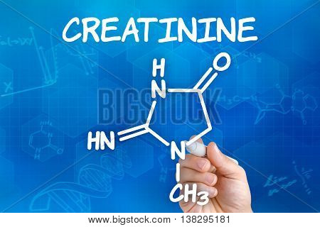 Hand With Pen Drawing The Chemical Formula Of Creatinine