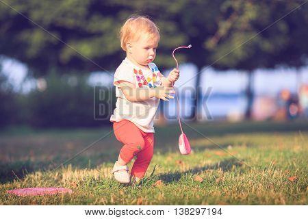 Baby playing on оutdoors. Computer mouse, technologies.