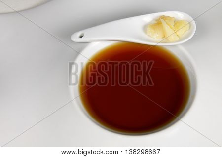 Modern plate of onion soup and Parmesan cheese