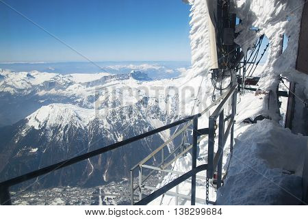 Chamonix valley panoramic aerial view from Aiguille du Midi mountain peak. Popular touristic destination.