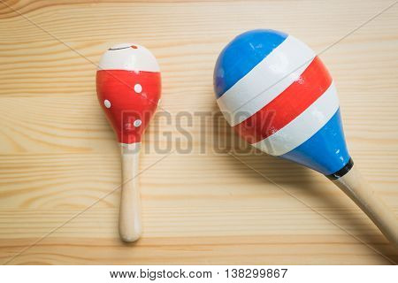 brightly coloured children;s wooden rattle and shaker toys