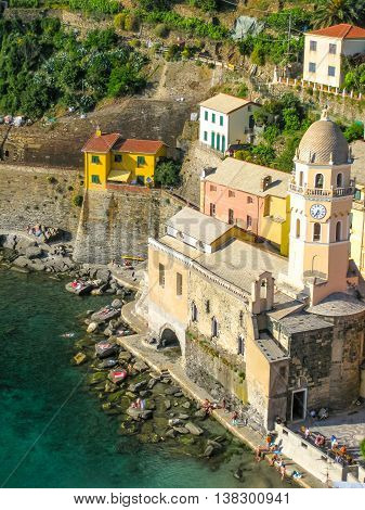 Vernazza in National Park of Cinque Terre. Aerial view of church Santa Margherita from the Tower of Doria Castle. Unesco Heritage. Liguria, Italy.