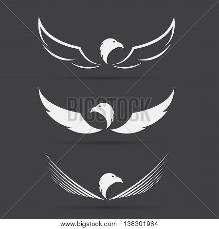 Vector image of an eagle design on black background Eagle logo for your design.