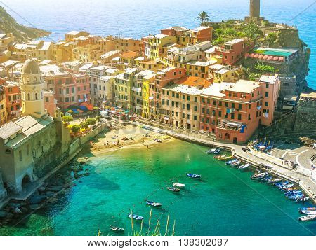 Aerial View of Vernazza at sunset, one of the jewels of Cinque Terre National Park, Unesco Heritage. Liguria, Italy.