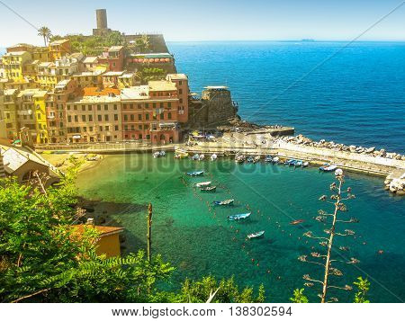 Panoramic View of Vernazza at sunset, one of the jewels of Cinque Terre National Park, Unesco Heritage. Liguria, Italy.