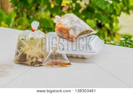 foam containers and plastic bags for take away food orders is a hidden health hazard, unhealthy food