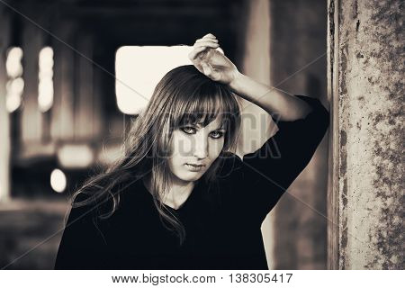 Girl recline on the wall
