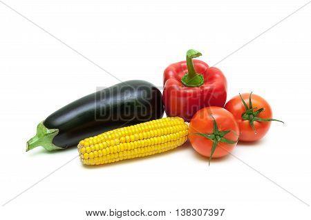 tomatoes corn eggplant and pepper closeup. white background - horizontal photo.