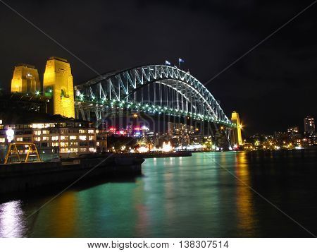Night time view of Sydney harbor and landmarks
