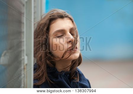 Fashion Portrait Of Stylish Pretty Woman Posing On The Street In Cloudy Day. Wearing Trendy Urban Ou