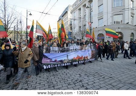 VILNIUS, LITHUANIA - MAR 11: Around one thousand people gathered with flags in a nationalist rally at Gedimino Avenue on Re-Establishment of Independence Day on March 11, 2013 in Vilnius, Lithuania