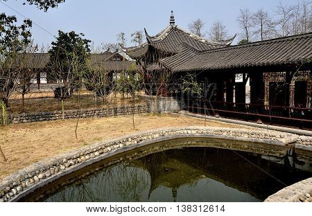 Sheng Pin China - March 7 2013: A small pond and outer pavilions at the General Yin Chang Heng Historic House Museum