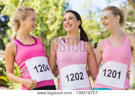 Young athlete women smiling in park