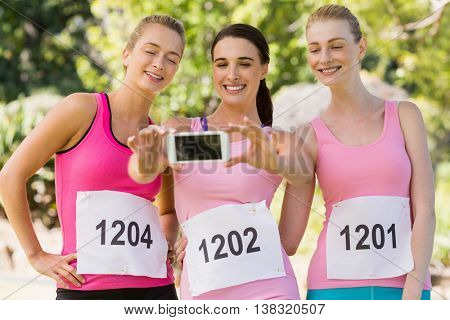Young athlete women taking selfie in park