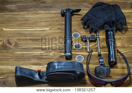 Items replacements and tools for a safe cycling: Gloves glasses pumps patches tire chain tool. Tools and accessories set for cycling