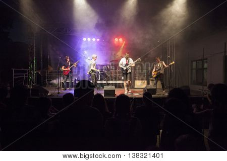 Rimetea (Torocko), Romania - July , 2016: The  hungarian singer Baricz Gergo and his band performing at the Doublerise festival, the first multi art festival from Transylvania on July 1, 2016