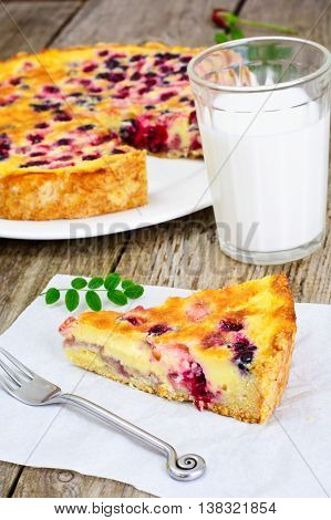 Cake with Strawberries, Blueberries, Currants and Raspberries, Creme Brulee on Rustic Boards Studio Photo