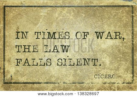 In times of war the law falls silent - ancient Roman philosopher Cicero quote printed on grunge vintage cardboard