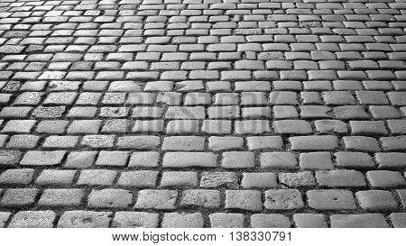 Black And White Photo Of Cobblestone Pavement