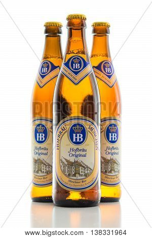 Munich Germany - June 11 2016: The three bottles of cold light original lager beer from Bavarian Hofbrau Munich brewery. Backlit and isolated on white stock photo.